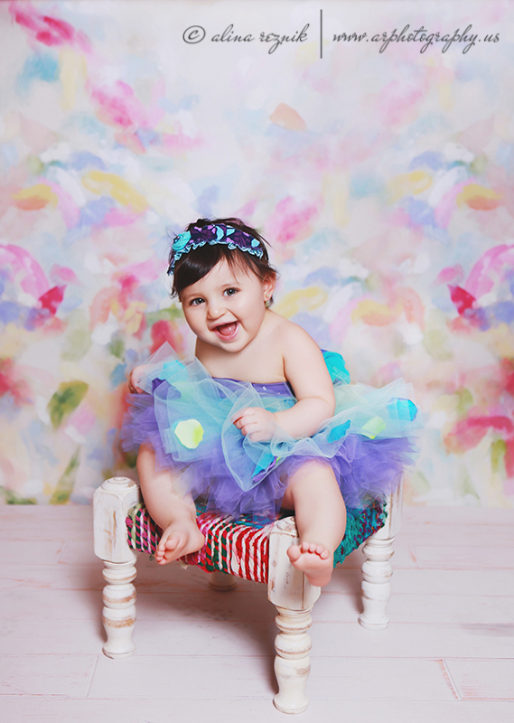 Happy Baby on a Colorful Chair