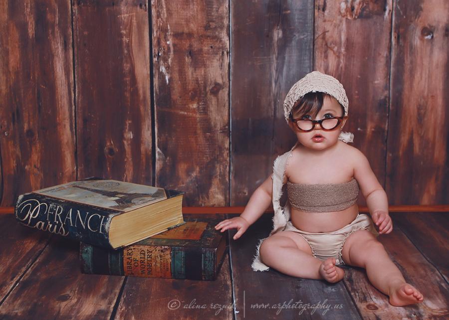 Baby Posing as a librarian