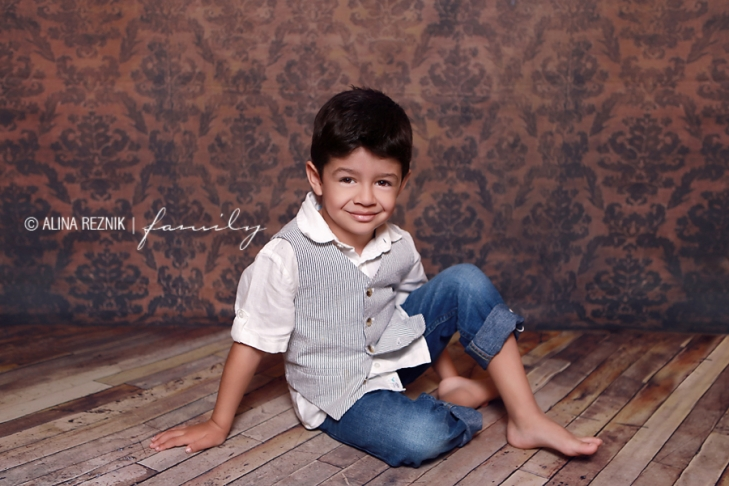 Boy posing for Alina Reznik, New York City based photographer