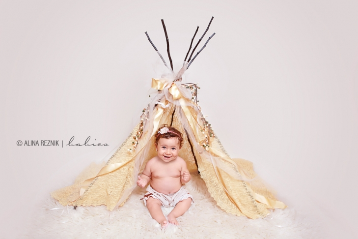 Professional Baby Photographer captured a girl sitting in an ornate tippi in her New York City Based Studio