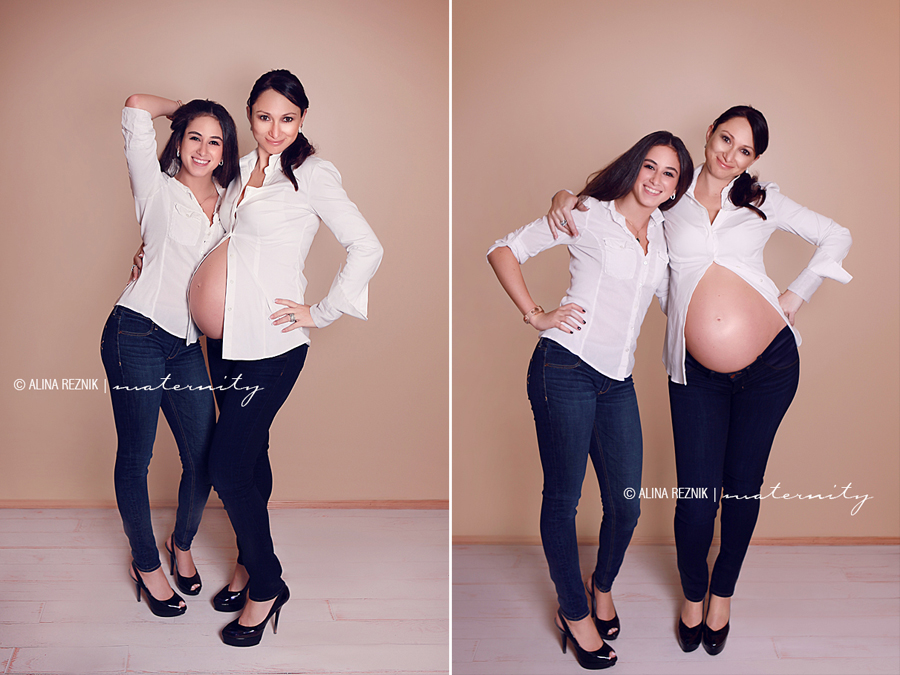 Teenage daughter with her pregnant mother posing and smiling at the camera during a Maternity Photography Shoot in New York City photo studio