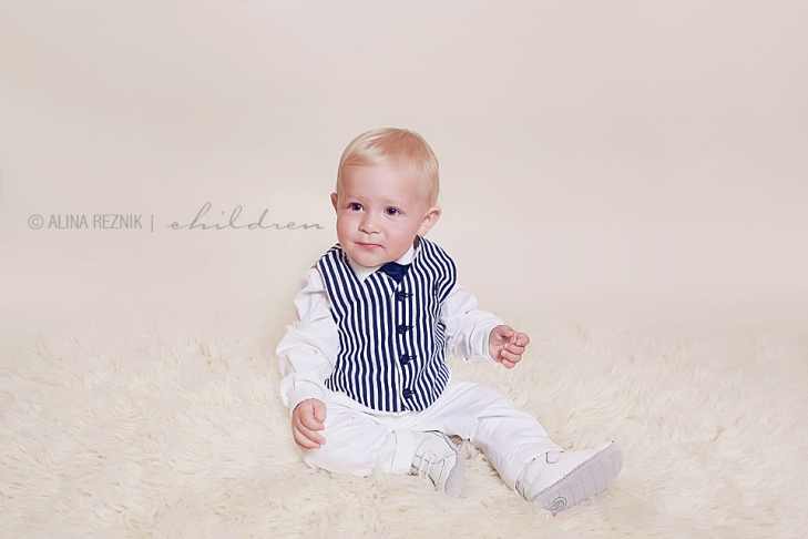 Baby boy is wearing classy clothes during his baby photography session in Brooklyn New York