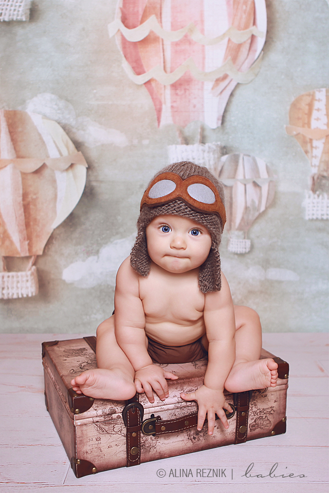 Child wearing flying glasses and vintage hat during his Baby Photography Session in Staten Island, New York
