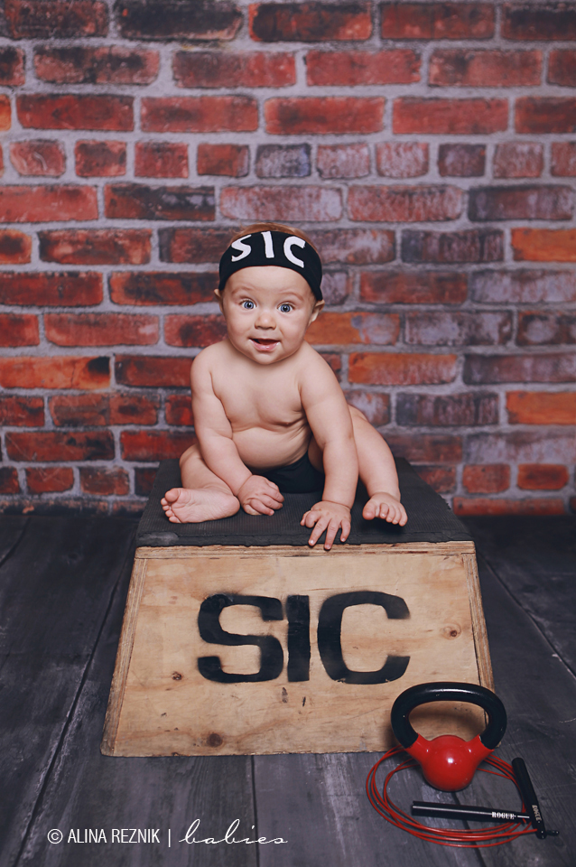 A baby wearing crossfit gear posing for a photographer during a Baby Photography Session in New York City