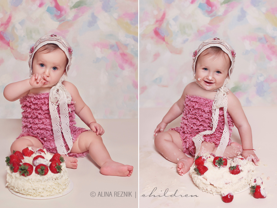 Baby is smashing a birthday cake during her New York Child photography session by Alina Reznik