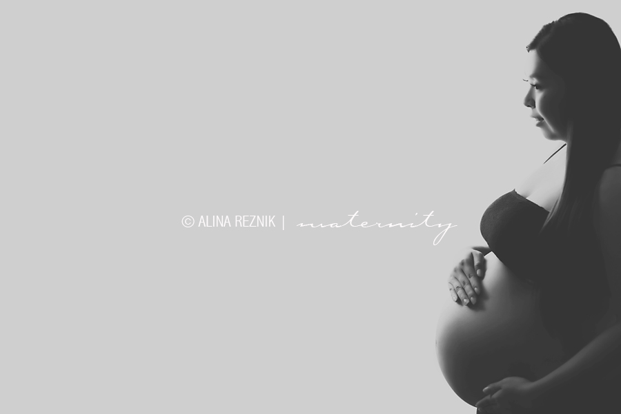 Alina Reznik a New York City based maternity photographer creates a silhouete for a pregnant woman in a natural setting.