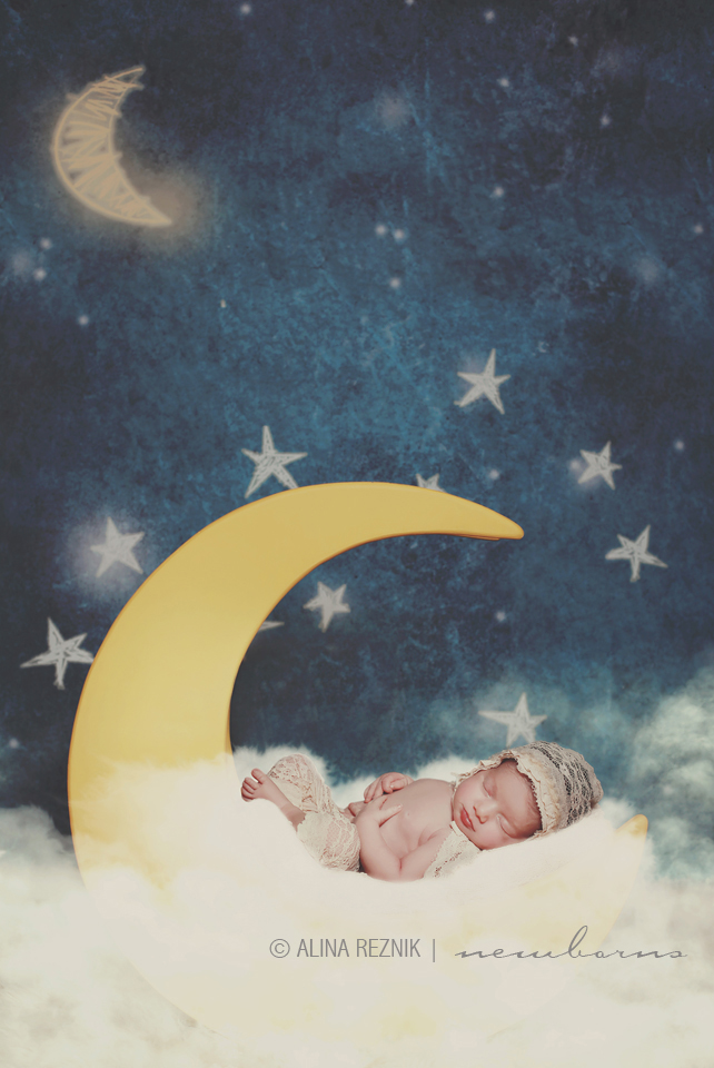 Stars themed photoshoot with a newborn positioned to look at the sky overlooking by the moon