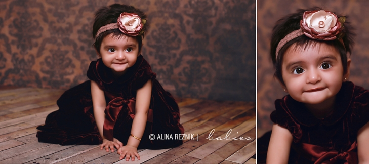 During her Baby Photography Session in Brooklyn New York Samayra is smiling at the camera while wearing a suade dress and a flower headband