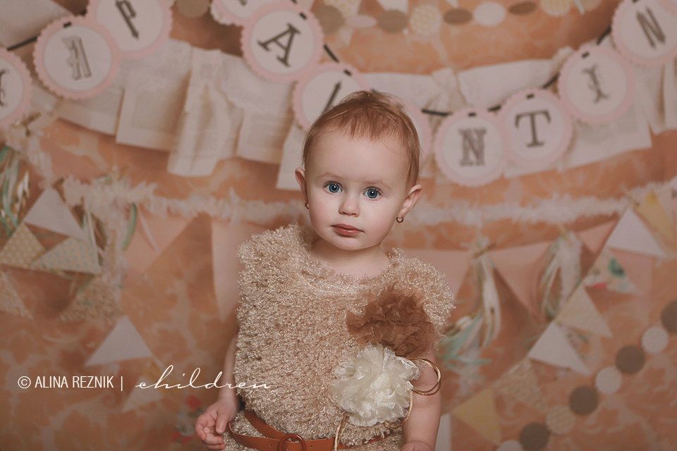 Valentine themed photo session with a very serious baby girl looking at the camera.