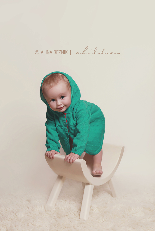 Baby wearing a green hoodie during a photography session in New York City