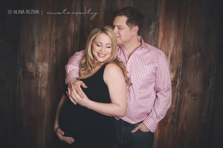 During a Maternity photo shoot a couple who is clearly in love is posing for the camera